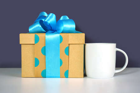 Fathers Day or masculine birthday theme coffee mug styled with gift.