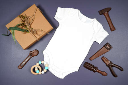 Fathers Day or masculine birthday theme baby romper flatlay mockup.