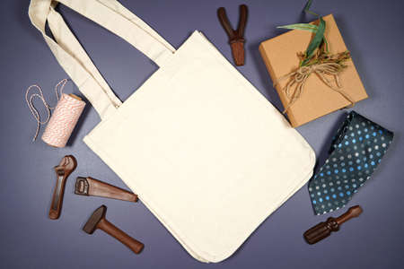 Fathers Day or masculine birthday canvas tote bag flatlay mockup.