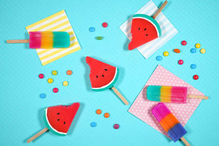 Summer beach vacation theme flatlay styled with watermelon and ice creams