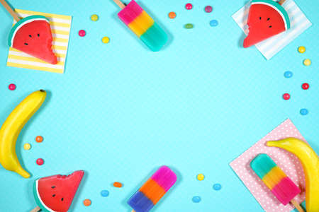Summer beach vacation theme flatlay styled with watermelon, candy and ice creams