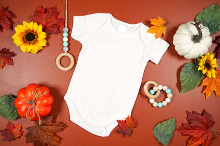 Autumn leaves and pumpkins theme product mockup flatlay on brown background