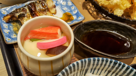 Japanese food set consist of grilled fish, tempura and  steamed eggs. 写真素材