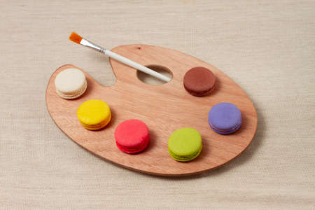 palette with colored macaroons, horizontal Reklamní fotografie
