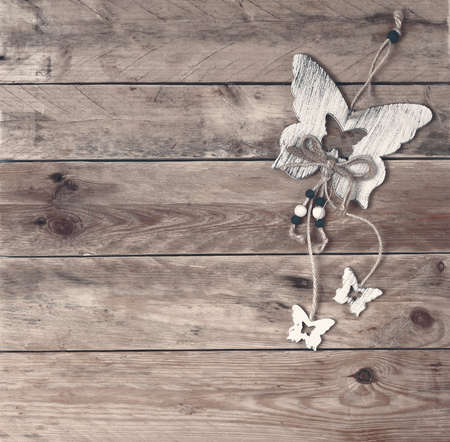 beige background, plywood topper butterfly , from wooden boards, horizontal