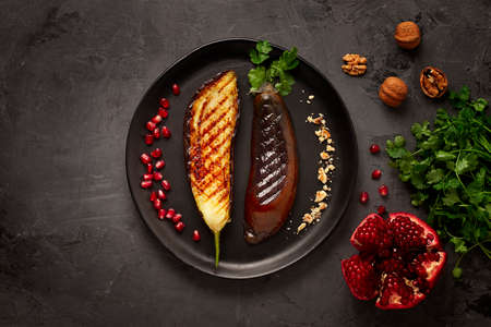 Fried eggplant, grilled, on a black background, horizontal, no people,