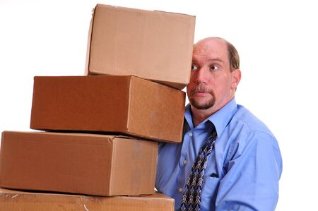 carrying: Business man panicking as he precariously carries heavy boxes, trying to balance them in front of him without the boxes toppling over.
