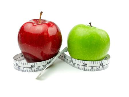 vs: Green Apple and Red Apple with measuring tape on white background