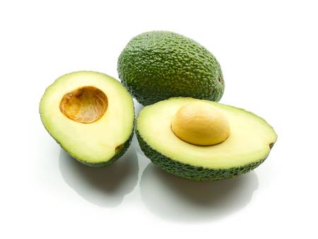 Avocados with reflection on white background photo