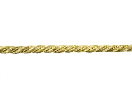 lineas rectas: Cuerda de oro sobre fondo blanco Foto de archivo
