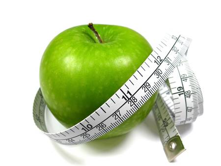 dietetics: Green Apple and measuring tape on white background