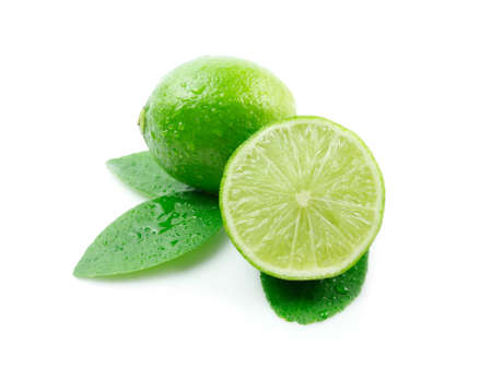 close quarters: Green lemons or lime with leaves on white background