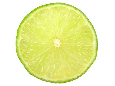seedless: Green lemon or lime slice on white background