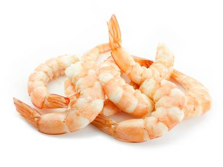 Peeled shrimps on white background