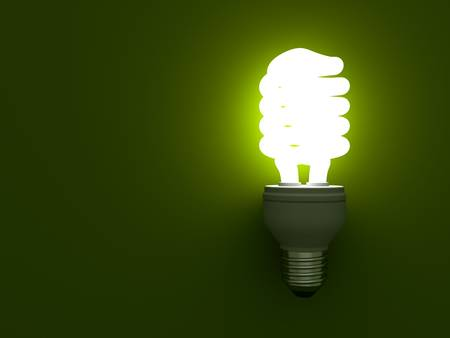 save electricity: Eco energy saving compact fluorescent light bulb glowing on green