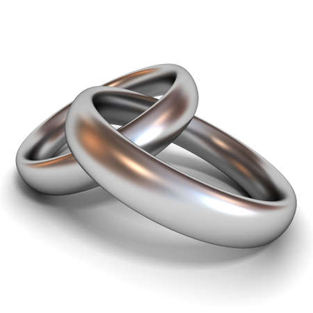 Silver wedding rings on white background photo
