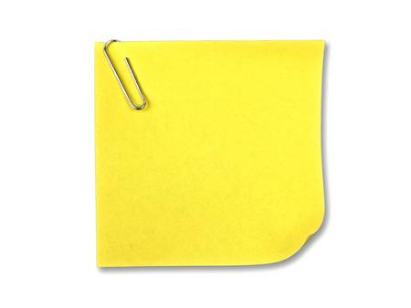 Yellow sticky note with clip on white background photo