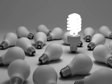 different thinking: Eco energy saving light bulb concept, one glowing compact fluorescent light bulb amongst the unlit incandescent bulbs on white background Stock Photo