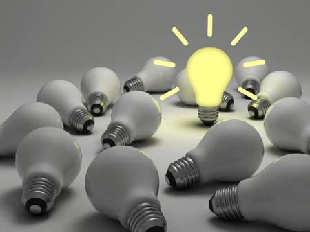 Idea concept, One glowing light bulb standing out from the unlit incandescent bulbs on white background