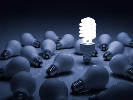 eficiencia energética: Eco de energía bombilla de ahorro, un brillante bombilla fluorescente compacta de pie entre las bombillas incandescentes sin luz con la reflexión Foto de archivo