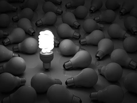incandescent: It s time for energy saving light bulb, one glowing compact fluorescent light bulb standing out from the unlit incandescent bulbs