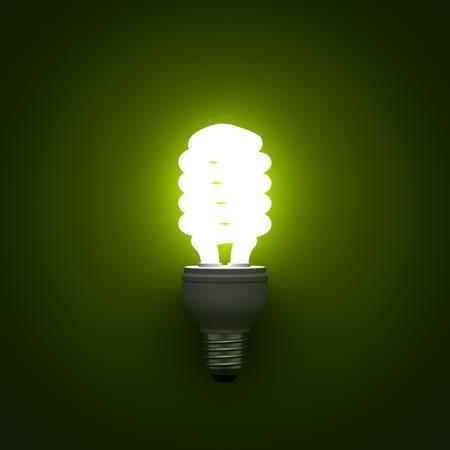 tubos fluorescentes: Ahorro de energ�a bombilla fluorescente compacta brillando sobre fondo verde