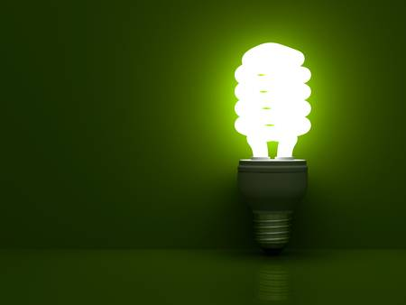 fluorescent tube: Energy saving compact fluorescent light bulb glowing on green background with reflection