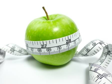 dietetical: Green Apple and measuring tape on white background