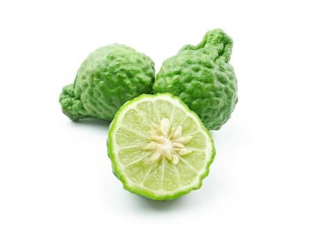 kaffir: Kaffir Limes over white background Stock Photo