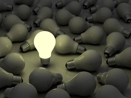 lightbulb idea: One glowing light bulb standing out from the unlit incandescent bulbs Stock Photo