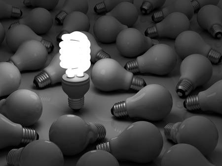 eficiencia energética: Que s tiempo para bombilla de ahorro de energía, una brillante bombilla fluorescente compacta de pie fuera de las bombillas incandescentes sin luz Foto de archivo