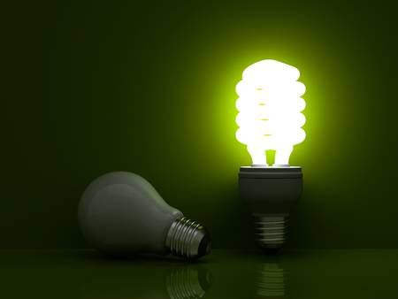 fluorescent lamp: It s time for energy saving light bulb, Glowing compact fluorescent light bulb standing near unlit incandescent light bulb on green background Stock Photo