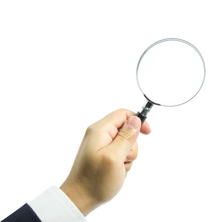 Magnifying glass in hand over white background