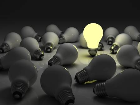 conceptual bulb: One glowing light bulb standing out from the unlit incandescent bulbs with reflection , The business concept and individuality concept Stock Photo