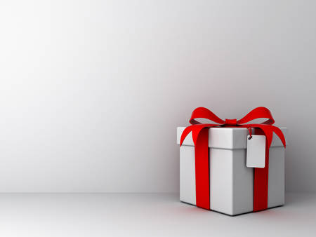 Gift box with red ribbon bow and blank tag on empty white wall background abstract Stock Photo - 23042005