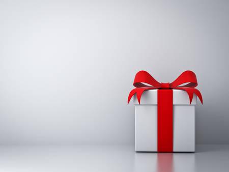 compleanno: Confezione regalo con fiocco di nastro rosso e sfondo astratto vuoto muro bianco