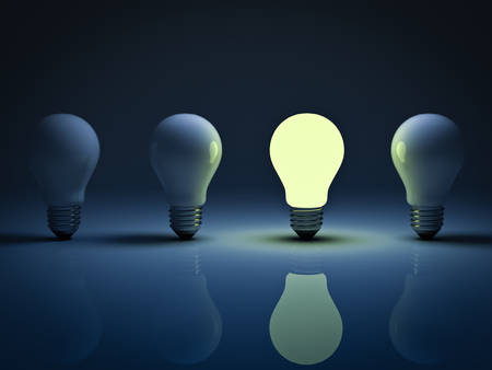 One glowing light bulb standing amongst the unlit incandescent bulbs with reflection , the different concept