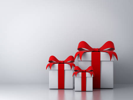 Gift boxes with red ribbon bow and empty white wall background abstract photo