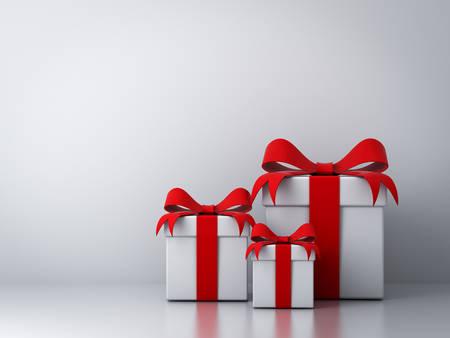 Les coffrets cadeaux avec n?ud de ruban rouge et vide mur blanc fond abstrait