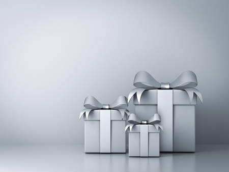 Gift boxes with silver ribbon bow and empty white wall background abstract Standard-Bild