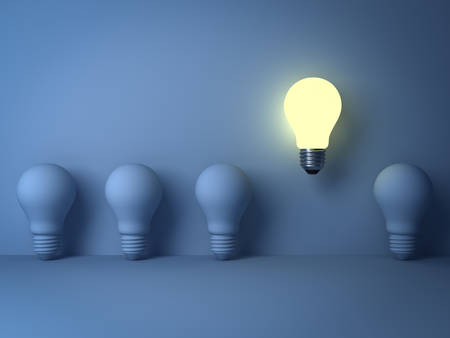 One glowing light bulb standing out from the unlit incandescent bulbs on blue background with shadow , The business concept and individuality concept . 3D rendering.