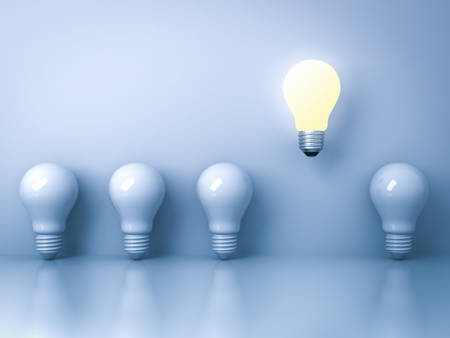 One glowing light bulb standing out from the unlit incandescent bulbs on blue background with reflection , individuality and different creative idea concepts . 3D rendering.