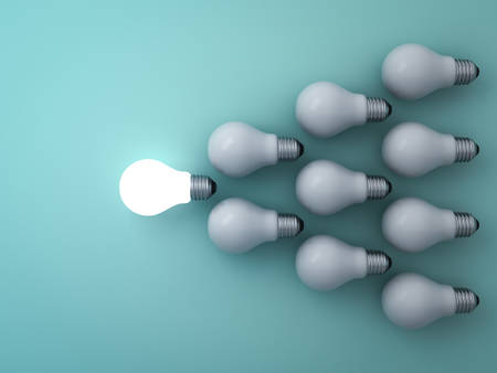 One glowing light bulb standing out from the unlit incandescent bulbs on green background , leadership and different concept . 3D rendering. Stock Photo