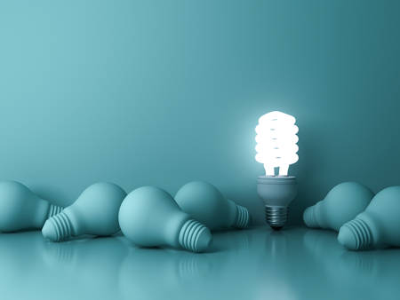 Energy saving light bulb , one glowing fluorescent lightbulb standing out from dead incandescent bulbs on green background , individuality and different creative idea concepts . 3D rendering.