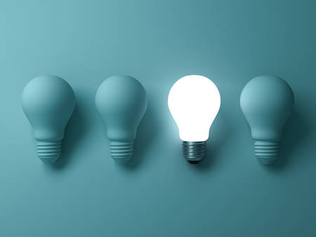 One glowing light bulb standing out from the unlit incandescent bulbs on green background , individuality and different creative idea concepts . 3D rendering.
