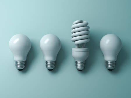 lamp shade: Energy saving light bulb , one compact fluorescent lightbulb standing out from unlit incandescent bulbs on green background , individuality and different creative idea concepts . 3D rendering.