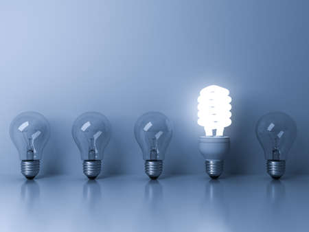concepts and ideas: Eco energy saving light bulb , one glowing fluorescent lightbulb standing out from unlit incandescent bulbs reflection on blue background , individuality and different ideas concepts . 3D rendering.