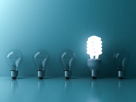 Eco energy saving light bulb , one glowing fluorescent lightbulb standing out from unlit incandescent bulbs reflection on blue background , individuality and different ideas concepts . 3D rendering.