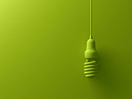 color background: Green eco energy saving compact fluorescent light bulb hanging isolated on green background with shadow , the same color abstract creative idea concept . 3D rendering. Stock Photo