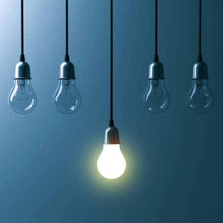 idea: One hanging light bulb glowing different and standing out from unlit incandescent bulbs with reflection on dark cyan background , leadership and different business creative idea concept. 3D rendering.
